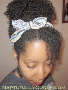 puff with a headband tied into a bow